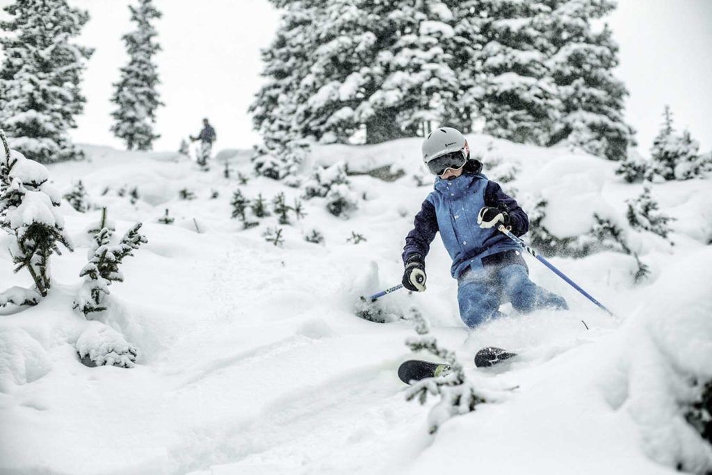 <b>Kid skis in powder in Vail, CO.</b>